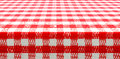 Table perspective view with red checked picnic tablecloth covered by Stock Photo