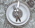 Table place setting with African beaded place mats Stock Photo