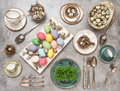 Table place setting with colored eggs. Easter dinner Royalty Free Stock Photo