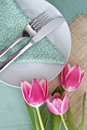 Table place setting with tulips for easter Stock Image