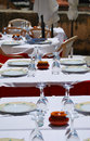 Table with plates, cups and cutlery Royalty Free Stock Photography