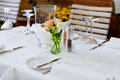 Table in restaurant tableware glass banquet summer napkin silver white Royalty Free Stock Photo