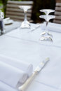 Table in restaurant tableware glass banquet summer napkin silver white Royalty Free Stock Photos