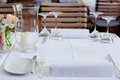 Table in restaurant tableware glass banquet summer napkin silver white Royalty Free Stock Images