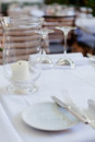 Table in restaurant tableware glass banquet summer napkin silver white Stock Image