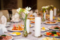 Table served with a meal in a restaurant candles and flowers Royalty Free Stock Image