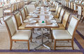 Table set before an event party or wedding reception in ballroom Royalty Free Stock Photo
