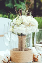 Table set for an event party or wedding reception banquet. Winter bridal bouquet of white carnations, peony, roses Royalty Free Stock Photo