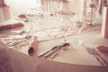 Table set for wedding or another catered event dinner empty glasses cutlery and napkin on the colorized photo Royalty Free Stock Photos
