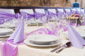 Table set for a wedding dinner empty glasses cutlery on the silver and purple decoration Royalty Free Stock Photo
