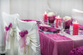 Table set for wedding or event party in pink rose and purple Stock Image