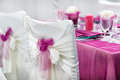 Table set for wedding or event party in pink rose and purple Stock Images