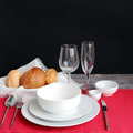 Table setting with bread rolls on a red napkin. Royalty Free Stock Photo