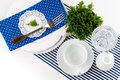 Table setting for breakfast with napkins cups plates in blue on a white background isolated Royalty Free Stock Photography