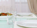Table setting for dinner empty glasses set and salad at home Stock Photography