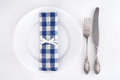 Table setting with fork, knife and blue checkered napkin Royalty Free Stock Photo