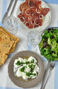 Table setting for italian dinner with fresh bread salad mozzarella and prosciutto Royalty Free Stock Images