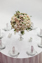 Table setting at a luxury wedding reception. Beautiful flowers on the table. Royalty Free Stock Photo