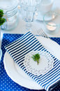 Table setting in navy blue tones for breakfast with napkins cups plates on a white background Royalty Free Stock Photography