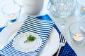 Table setting in navy blue tones for breakfast with napkins cups plates on a white background isolated Royalty Free Stock Image