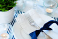 Table setting in navy blue tones for breakfast with napkins cups plates on a white background isolated Stock Photos