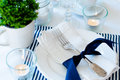 Table setting in navy blue tones for breakfast with napkins cups plates on a white background isolated Royalty Free Stock Photos