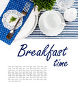 Table setting in navy blue tones for breakfast with napkins cups plates on a white background isolated Stock Photography