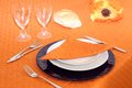 Table setting on orange table cloth Royalty Free Stock Photo