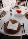 Table setting, outdoor dining patio area Royalty Free Stock Photo