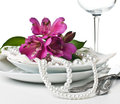 Table setting with pink alstroemeria flowers Royalty Free Stock Image