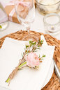Table setting with pink flowers Royalty Free Stock Image