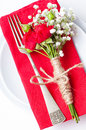 Table setting with red roses, napkins and vintage crockery Stock Photos