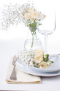 Table setting with roses in bright colors and vintage crockery Stock Photos