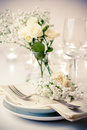 Table setting with roses in bright colors and vintage crockery Royalty Free Stock Photography