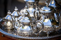 Table setting with silver tea or coffee cups Royalty Free Stock Photo