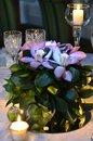 Table setting wedding event candles orchid roses flowers bouquet Royalty Free Stock Photography