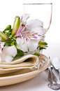 Table setting with white alstroemeria flowers Royalty Free Stock Image
