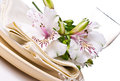 Table setting with white alstroemeria flowers Royalty Free Stock Images