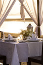 Table setup for dinner romantic on the beach Royalty Free Stock Photography
