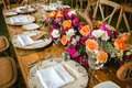 Table setup, wedding guest table, reception layout in pantone living coral and deer horns rustic style