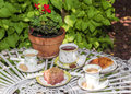 A table with tea, coffee, sweets and pastries Royalty Free Stock Photo
