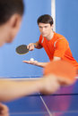Table tennis game two young people playing Royalty Free Stock Photography