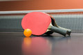 Table tennis racket with  ball on black table Royalty Free Stock Photo