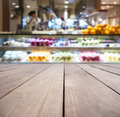 Table top with Blurred Bar with fresh Fruit Display on background Royalty Free Stock Photo