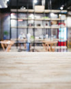 Table top counter bar restaurant interior blurred background with shelf Royalty Free Stock Photos