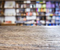 Table top Counter with Blurred Bookshelf Bookshop Background Royalty Free Stock Photo