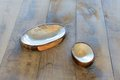 Table with two ashtrays from seashells wooden Royalty Free Stock Images
