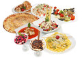 Table with various food plates arrangement restaurant focaccia pizza Stock Photography