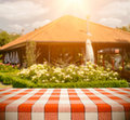 Tablecloth on restaurant red checkered outdoors against background Royalty Free Stock Image