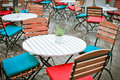 Tables and chairs outside in the rain Royalty Free Stock Image